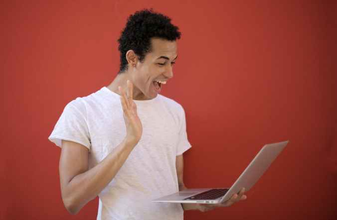cheerful man using laptop for video call